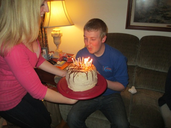 Hubby blowing out his candles.. sure hope he made a great wish, he definitely earned it!! lol