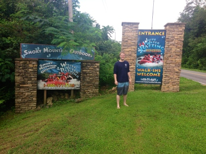 Matt in front of the White Water Rafting companies sign