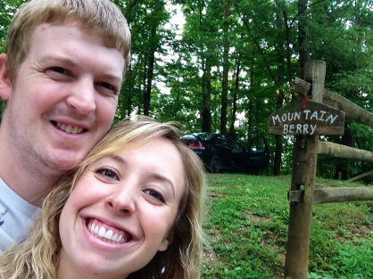 Getting a picture with the Mountain Berry cabin sign!