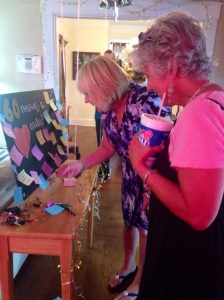 Mom and Aunt Jo looking at her 60 reasons we love Cathy board!