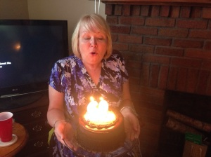 Blowing out her candles and making a wish!