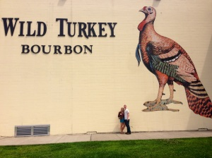 Feeling small in front of the Wild Turkey Sign