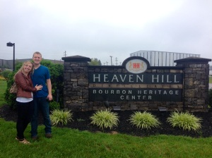 In front of the sign at Heaven Hill
