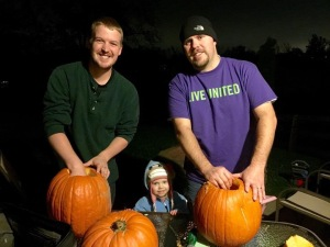 The guys and Kenzie carving Pumpkins