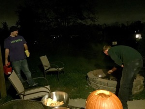 Matt & Matt making the bonfire. One has the gas can, the other has the match lol