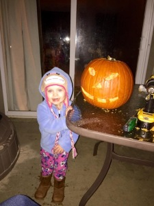 Kenzie and he Jack-O-Lantern
