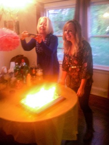 Admiring the pretty glow of the cake before blowing out the candles!