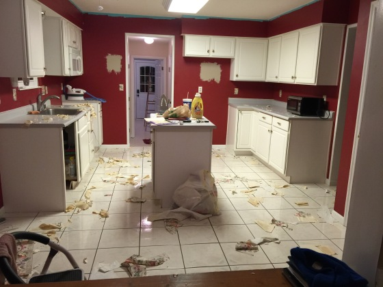 The kitchen after the wallpaper was stripped and before we painted!
