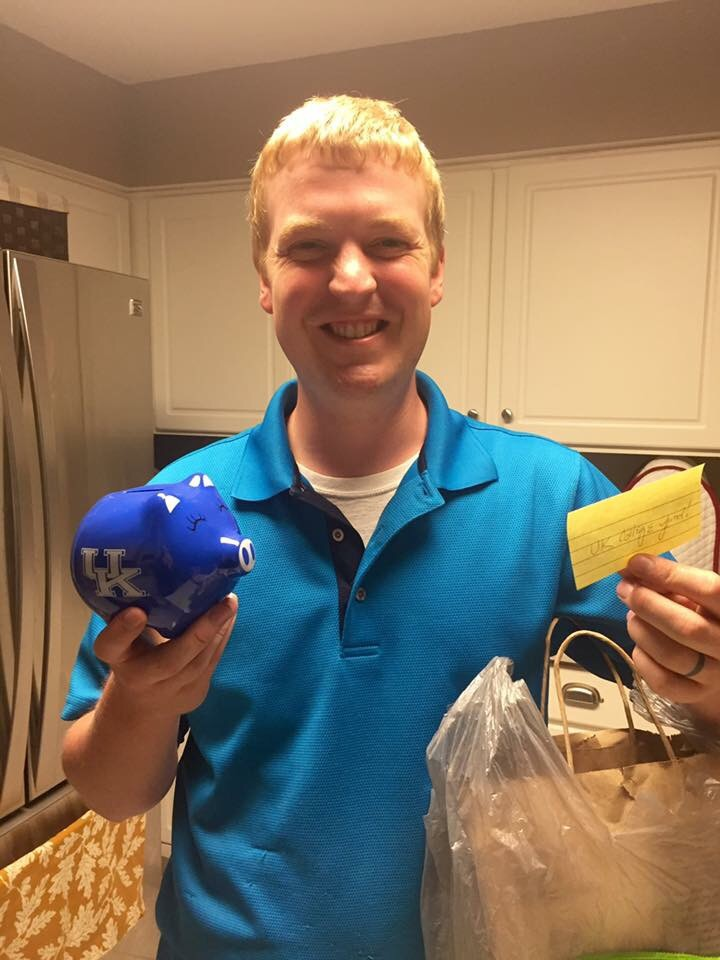 Matt with his UK college fund from his awesome mother in-love for fathers day! Never to early to start saving for our little Wildcats!