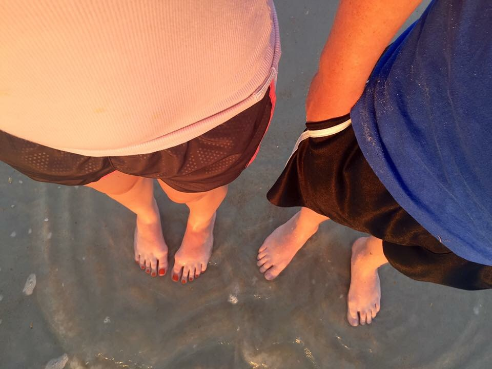 We've got our toes in the water, toes in the sand!