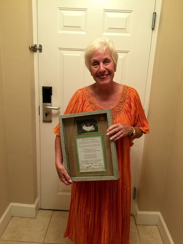 Nana with her shadowbox from her first great-grand daughter! This was the way we decided to surprise her and tell her that Sweet P is on her way! :)