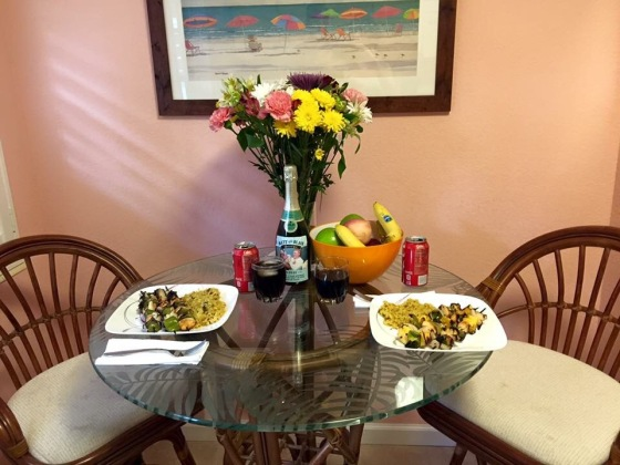 Dinner in our beach cottage! Matt grilled up some yummy citrus chicken kabobs! FYI for anyone that noticed, don't worry about the Champagne bottle in the background, we didn't drink it. It was a gift for our fruit and flower anniversary because grapes are fruit, and that is what Champagne is made out of so we had a label printed and put on a bottle of champagne from our wedding! It was only decoration along with the beautiful anniversary flowers :)