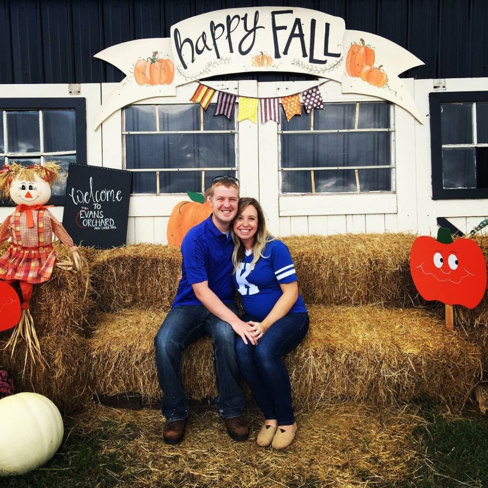 Family photo with Evans Orchards traditional photobooth! We can't wait till next year when that cute little bump is sitting on our laps instead of inside Blairs belly :)