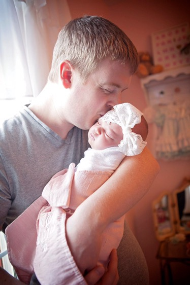 Wrapped up in her daddy's loving arms and her bow swaddle <3