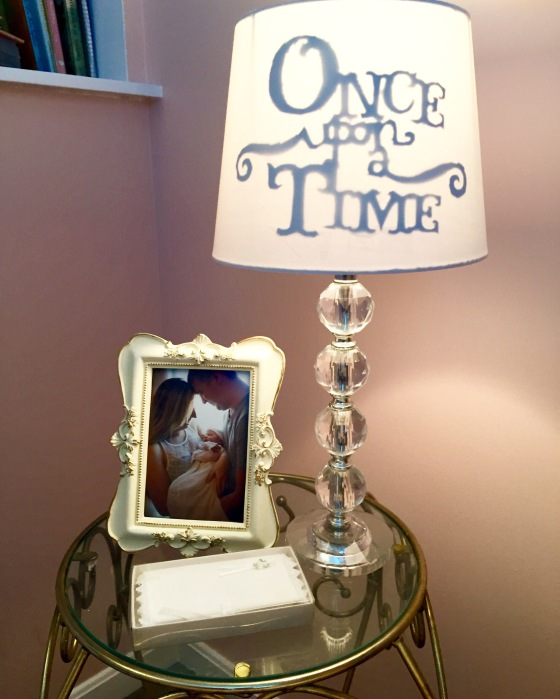 """Her """"Once Upon A Time"""" lamp that we hand stenciled, cut out and created for her specifically in mind as well as her little bible we gave her on the day of her dedication to God that's marked with special verses from her family with her in mind <3"""