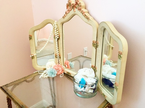 Her hair bow station complete with a table that used to belong to her Great-Grandma Jane and a mirror that used to sit in her mama's room when she was a little girl, along with a gazillon hair bows!