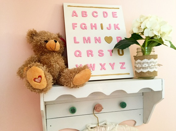 Annabelle's heartbeat bear that contains that sound of her heartbeat from when we were 16 weeks pregnant with her and the adorable ABC/I <3 U board that her Aunt Danielle made for her