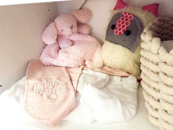 The swaddle we wrapped her up in to meet her family on the day she was born, and some sweet little lovies, both homemade and hand picked, with love for Annabelle that sit on the shelf in her closet.