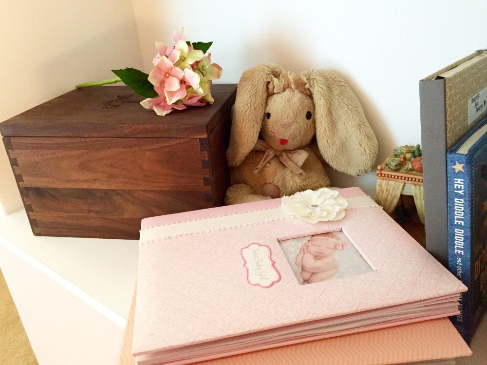 My bunny, Miss Snuggles, from when I was a little girl. She is stuffed with the blanket that I was wrapped in and brought home from the hospital in, and now she sits on Annabelles book shelf keeping watch over her all night and day long