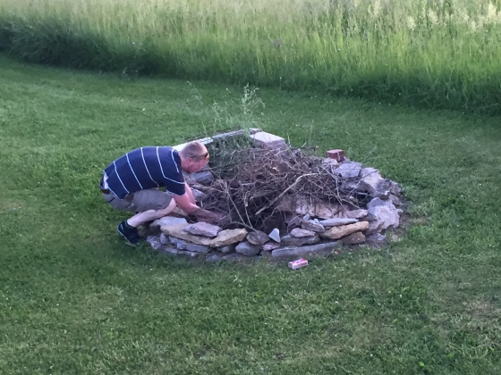 Daddy working hard doing one of his favorite things to do in the summer, build bon fires for roasting marshmallows and making smores!