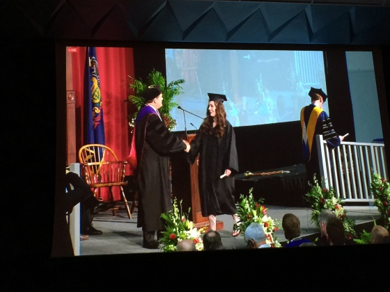 Accepting her diploma!!!