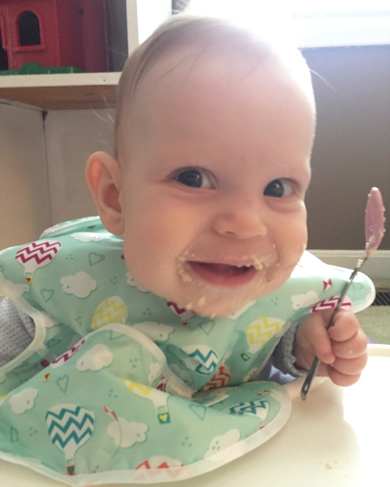 Loving her oatmeal and her spoon!