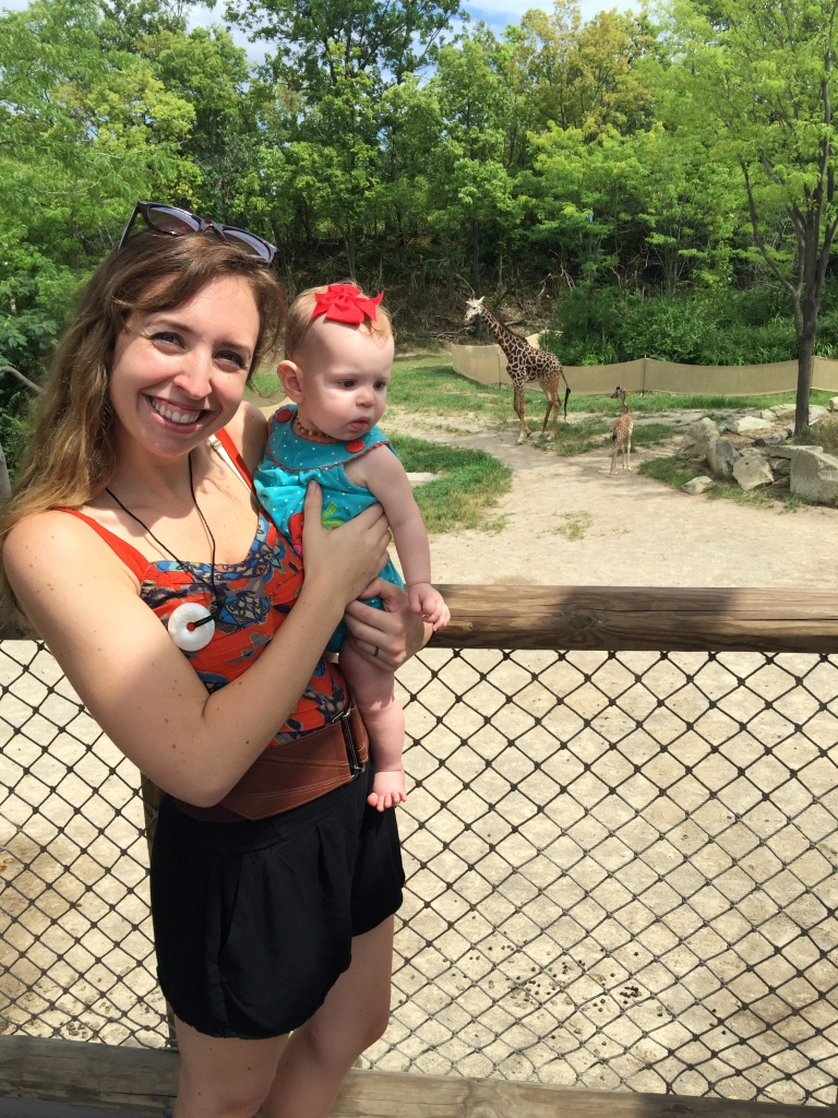 At the zoo with the baby and mommy giraffe in the background!