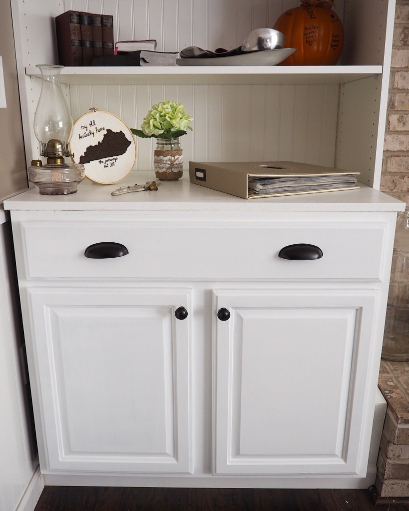We used General Finishes Milk Paint in Snow White for finish the cabinets. It was our first time working with milk paint and we loved how it turned out but it didn't come without the price of a lot of time and effort. We had to put 4 coats on each cabinet to get the whole thing covered!