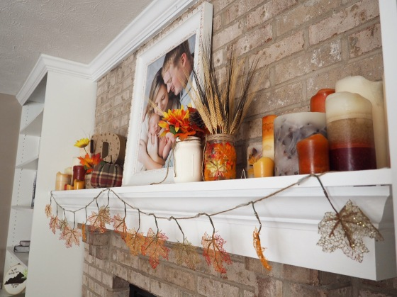 A fall inspired mantel with crown molding thanks to my handy mans hard work. Seriously crown molding is much more dificult to cut and install than one would think. I am so proud of him for not giving up and for figuring it out. He is so smart!