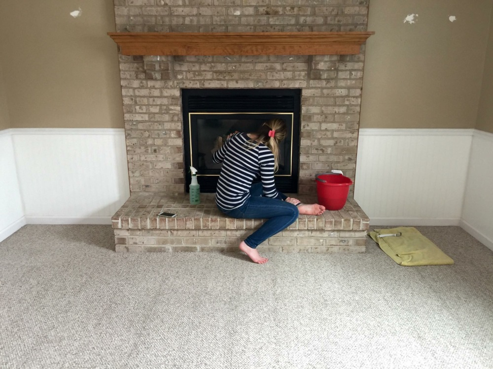 March 2015 - giving the fire place a good cleaning before move in weekend!