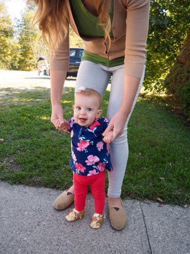 Our little walker in her Gold Moccasins