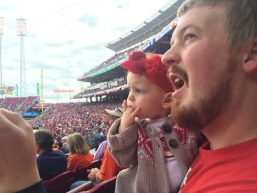 Dad telling Annabelle all about Baseball at her first game!